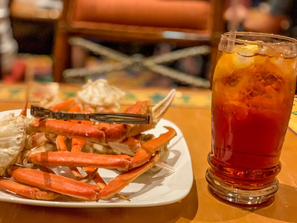 A picture of crab legs and sweet tea from the Beau Rivage buffet.