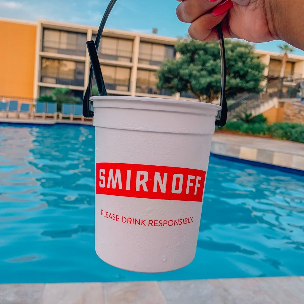 Smirnoff drink bucket by the Treasure Bay pool.